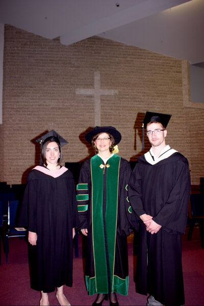 East Kildonan resident David Thiessen (right) is shown with fellow President's Medal recipient Nicole Richard (left) and Canadian Mennonite University president Cheryl Pauls at graduation exercises on April 28.