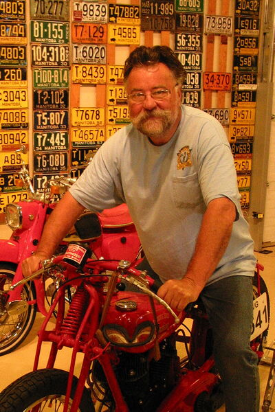 Antique motorcycle enthusiast Ross Metcalfe astride the Bonneville record breaking 1938 Indian Junior Scout.