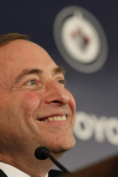 NHL commissioner Gary Bettman is all smiles as he talks to media before the Winnipeg Jets 2.0 inaugural game at the MTS Centre.