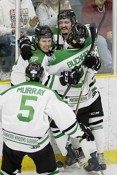 Portage Terriers' Ty Barnstable (27) celebrates scoring on Swan Valley Stampeders in first period of game five playoff action in Portage La Prairie Tuesday.    Reporter: sawatzky