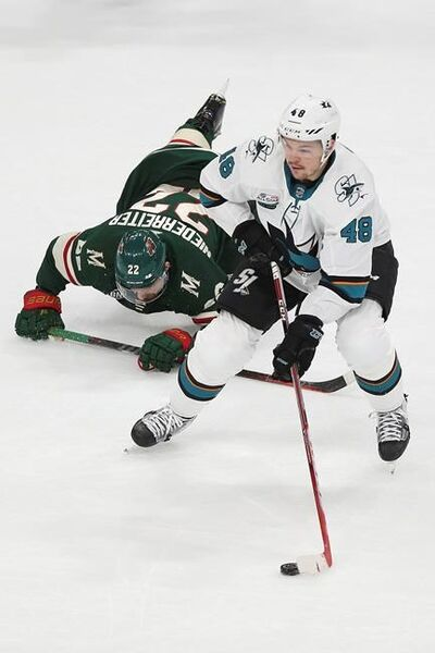 San Jose Sharks' Tomas Hertl of Czech Republic controls the puck after Minnesota Wild's Nino Niederreiter of Switzerland falls in the first period of an NHL hockey game Tuesday, Dec. 18, 2018, in St. Paul, Minn. (AP Photo/Stacy Bengs)