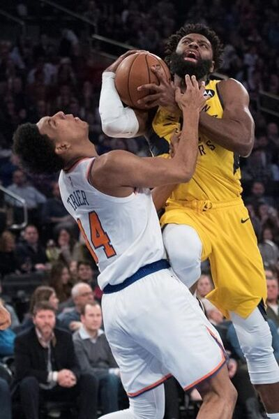 New York Knicks guard Allonzo Trier (14) fouls Indiana Pacers guard Tyreke Evans during the first half of an NBA basketball game Friday, Jan. 11, 2019, at Madison Square Garden in New York. (AP Photo/Mary Altaffer)
