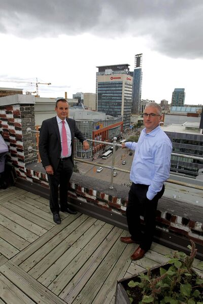 BORIS MINKEVICH / WINNIPEG FREE PRESS</p><p>Winnipeg real estate lawyer Jason Bryk (left) and Sunrex vice-president Phil McAmmond stand on the roof of the Sterling Building, which is being converted into affordable apartments downtown. </p>