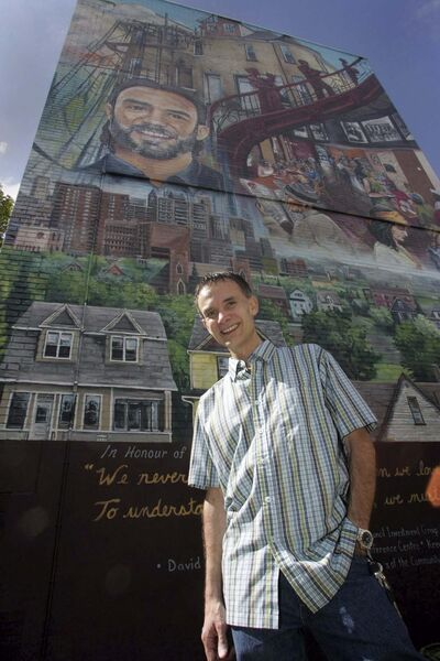 KEN GIGLIOTTI / WINNIPEG FREE PRESS FILES</p></p>Harry Lehotsky with the mural that bears his likeness.