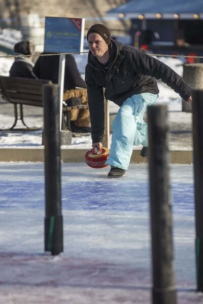 Clayton Salkeld throws a curling rock while playing Crokicurl with his family.