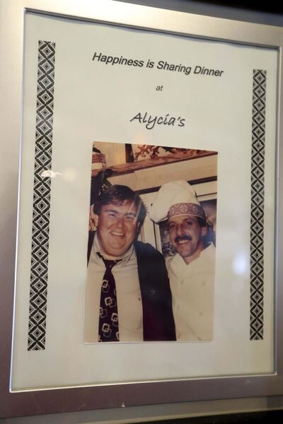 Celebrity photos (which include John Candy) from the original Alycia&#39;s line the walls of the New Alycia&#39;s.</p>