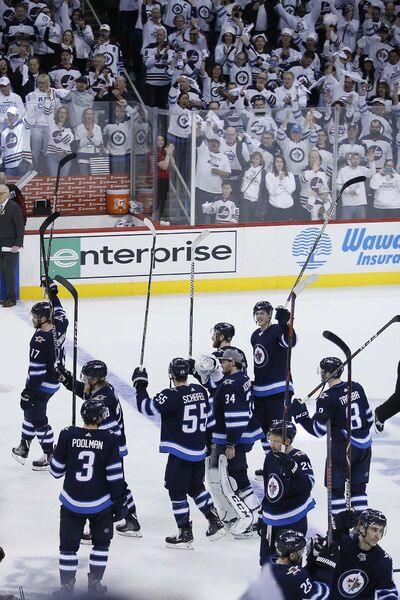 Winnipeg Jets celebrate defeatin the Minnesota Wild in game five NHL first round playoff action 4-1 in Winnipeg on Friday, April 20, 2018. THE CANADIAN PRESS/John Woods</p>