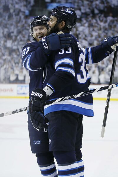 <p>Winnipeg Jets Kyle Connor (left) and Byfuglien celebrate Byfuglien's second goal of the game against the Predators on Tuesday night.</p>