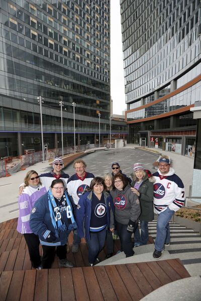TREVOR HAGAN / WINNIPEG FREE PRESS</p><p>We are Jets Family: (from left to right) Marie Mielke, Karl Mielke, Erin Myers, John Vermeer, Michelle Raposo, Carol Vermeer, Nicole Vinet, Paul Quaye, Barb Young and Mike Young.</p></p>