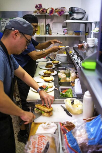 DANIEL CRUMP / WINNIPEG FREE PRESS</p><p>Southdale Village Family Restaurant cooks William Wong (front) and Chris Scott (back) at work during a busy lunch.</p>