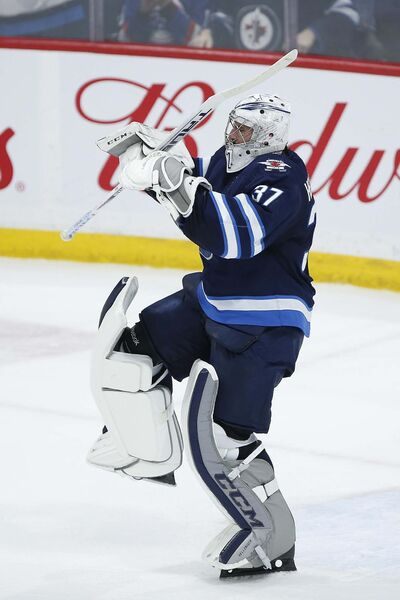 """Hellebuyck celebrates a 3-0 shutout against the Washington Capitals at the end of February. (John Woods / The Canadian Press files)</p> <p>""""> </a><figcaption readability="""