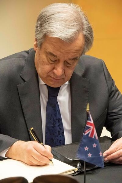 In this Thursday, March 21, 2019, photo provided by the United Nations, United Nations Secretary General Antonio Guterres signs the book of condolence at the New Zealand Mission in New York, for victims of the March 15, 2019, Christchurch mosque shootings. (Evan Schneider/The United Nations via AP)