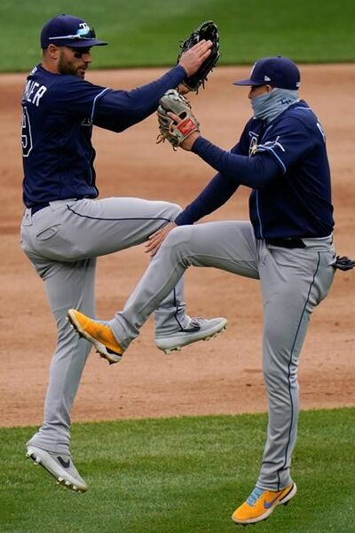 Tampa Bay Rays' Kevin Kiermaier, left, celebrates with teammate Willy Adames, right, after a baseball game against the New York Yankees Saturday, April 17, 2021, in New York. The Rays won 6-3. (AP Photo/Frank Franklin II)