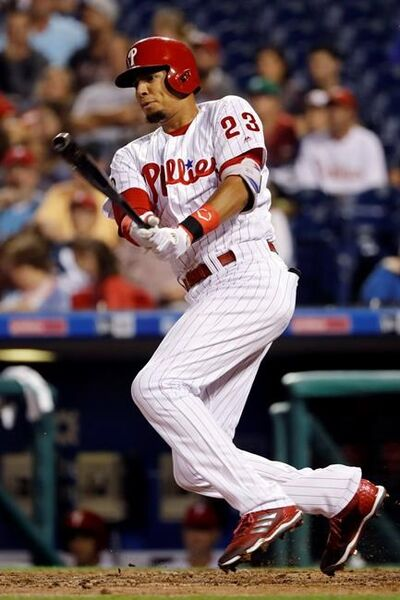 Philadelphia Phillies' Aaron Altherr follows through on an RBI double off Miami Marlins starting pitcher Dan Straily during the third inning of a baseball game, Wednesday, Sept. 13, 2017, in Philadelphia. (AP Photo/Matt Slocum)