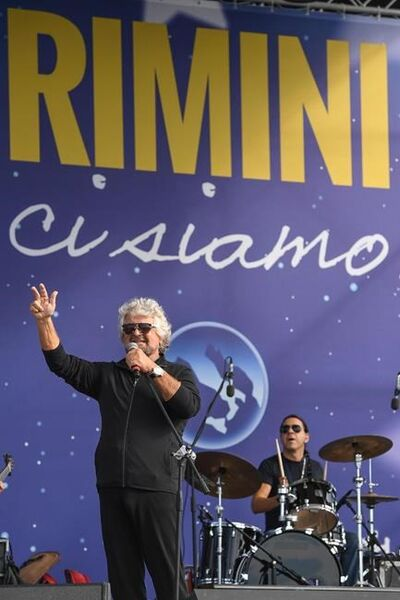 Leader of the Five Stars Moviment, Beppe Grillo performs on the stage during a meeting in Rimini, Italy, Saturday, Sept. 23, 2017 (Alessandro Di Meo/ANSA via AP)