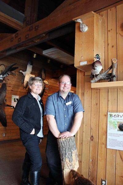 Volunteers at FortWhyte Alive build wood duck boxes for waterfront properties.
