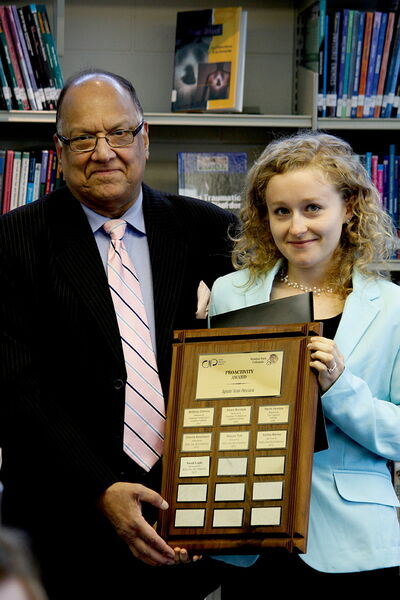 MLA Bidhu Jha presented his Proactivity Award to Windsor Park CIP recipient Sarah Lupky at the June 5 CIP Luncheon.