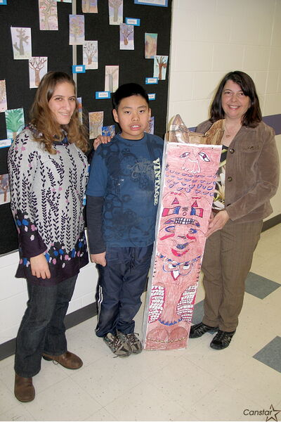 From left to right: École Riverbend Community School teacher Madeleine Kettner, student Karl Bulatao, and EA Elaine Paradis. Bulatao was selected to receive the Yes I Can award, handed out by the Manitoba Council for Exceptional Children. Karl is pictured with a totem pole he created from scratch, duplicating the intricate designs on a totem pole found in the schol's principal's office.