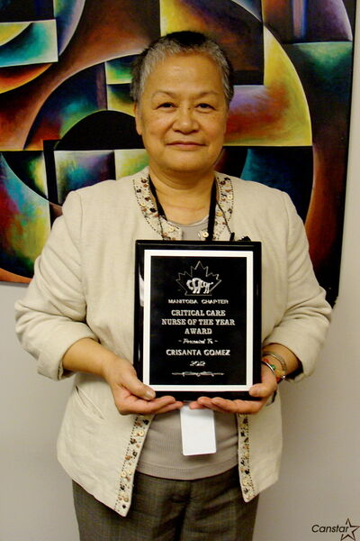 Crist Gomez with her award.