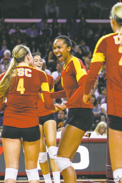 Alicia Ogoms celebrates a point with her USC teammates. Ogoms cracked the starting lineup early in her freshman season.