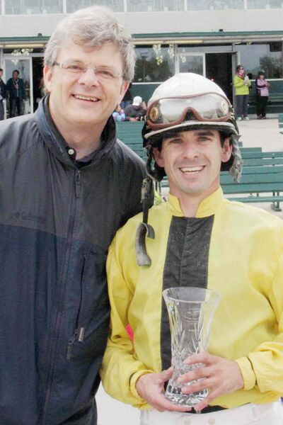 Canstar managing editor John Kendle with winning jockey Travis Cunningham. Cunningham, riding Go Go Lolo, won the $30,000 Canstar Canada Day Stakes July 1.