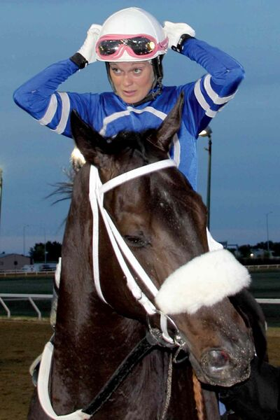 Janine Smith, the first woman to win the Winnipeg Futurity, on Zdeno.