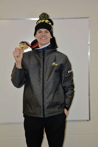 St. James speed skater Tyson Langelaar poses for a photo with one of his four gold medals from the Canada Winter Games in Red Deer, Alta. on Feb. 16.