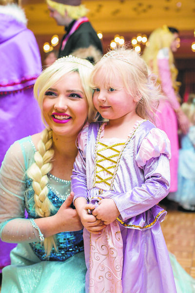 (Left) Julie Lumsden, otherwise known as Queen Elsa, poses for a picture at the Royal Princess Ball with Harley Morgan.