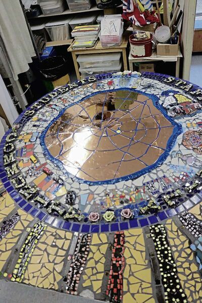 The mosaic was designed by the students and inspired the school's community treaty.