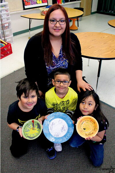Collicutt teacher Melissa Sigvaldason with Grade 1 students (from left) Desh Turner, Isiah Hanif and Demi Manaois.