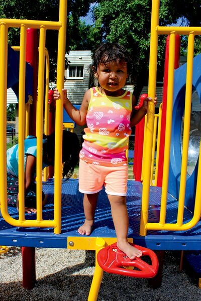 Two-and-a-half-year-old Kuri Anderson checks out one of the two new playgrounds at Elwick Village last week.