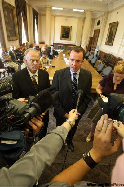 PC Leader Hugh McFadyen (right) and Liberal Leader Jon Gerrard speak with media at a mock committee meeting Tuesday at the Legislative Building.