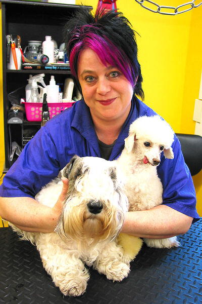 St. Vital resident Kim Gibson with her dogs Nevada (left) and Quinn at Vada's Club K9 on St. Anne's Road.
