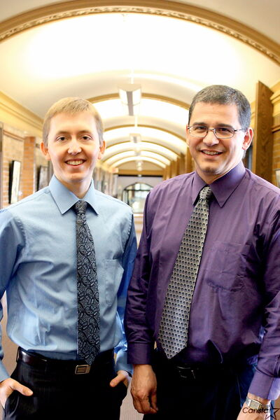 Student Josh Ewert (seen left) and Craig Martin, assistant professor of business and organizational administration at CMU, are excited about the new business school.