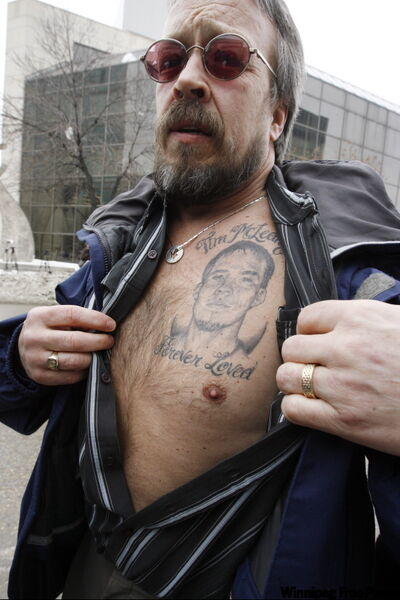 Tim Mclean Sr. displays a tattoo of his son outside court Thursday, after the judge handed down his verdict.