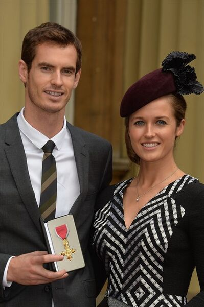 Wimbledon champion Andy Murray and his long time girlfriend Kim Sears pose for the camera after Murray received his Order of the British Empire (OBE) from Britain's prince William at Buckingham Palace in London, Thursday Oct. 17, 2013. (AP Photo/John Stillwell/Pool)