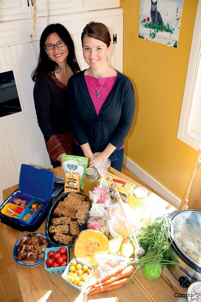 Sherry Rothwell (left) and Adrienne Percy show off some of the recipes featured on Dig In Manitoba, and some of their favourite fresh ingredients.