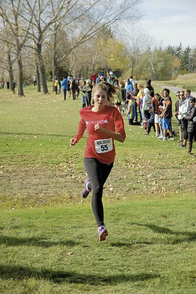 Varsity girls' champion Erin Valgardson, of Kelvin High School, approaches the finishing chute at the MHSAA high school cross-country championships on Oct. 11, 2017 at Kilcona Park.