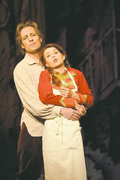 Marie (Nikki Einfeld) in the arms of her love, the young peasant Tonio (John Tessier), during Manitoba Opera�s production of Donizetti�s Daughter of  the Regiment.