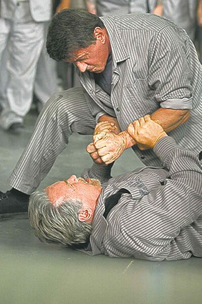 Who you calling a vegetarian?  Sly pins Arnold down in Escape Plan.Ph: Alan Markfield���� 2013 Summit Entertainment, LLC.  All rights reserved.