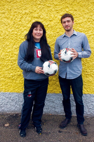 Dina LaBillois and Bryan Dueck of the Elmwood Community Resource Centre's Y.E.A.R. program are helping to bring University of Winnipeg Wesmen soccer players to teach free camps in the community.