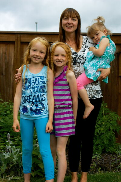 Former Transcona resident Kristen McDowell is shown with daughters Calla, Maya, and Aria. The family is organizing a run in memory of their daughter and sister Georgia, who died in 2009 of spinal muscular atrophy.