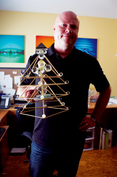 Chris Kehler is shown with a silverlight pyramid, which he says can affect the actions of spirits. Kehler will present at Winnipeg Paracon from July 12 to 14.