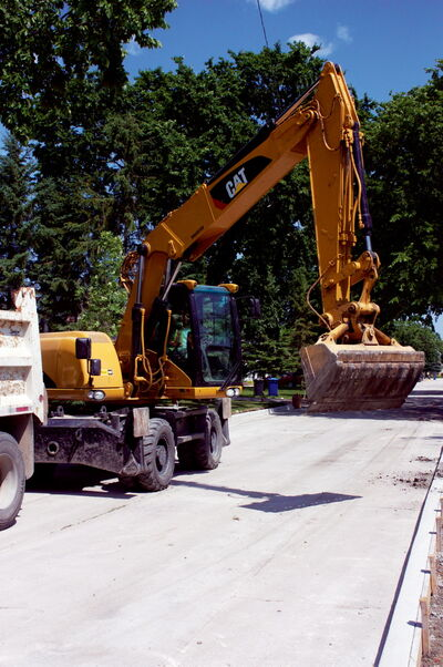 An excavator is shown near the corner of Walden Crescent and Blue Heron Crescent in Transcona. Walden Crescent is one of 17 streets that will be repaired using money from the Local Street Renewal Reserve Fund.