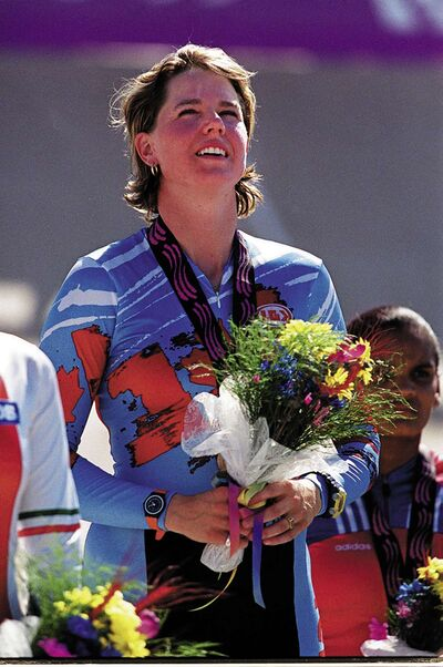 Tanya Dubnicoff listens to the Canadian national anthem on the medal podium after winning gold in the cycling sprint event at the 1999 Pan American Games in Winnipeg.