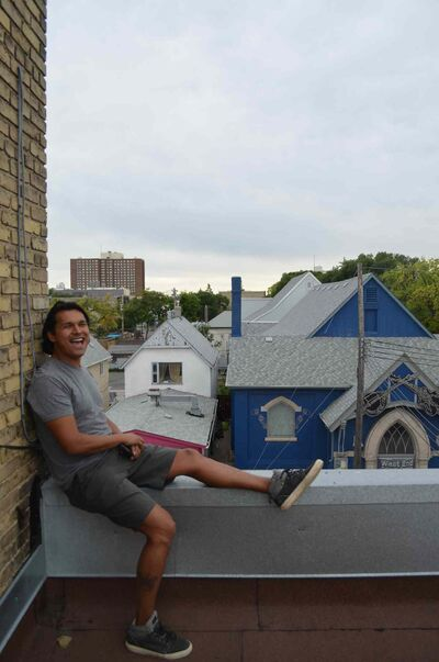 Actor Adam Beach sits atop the Ellice Theatre, now renamed the Bandwidth Theatre, in September 2014.