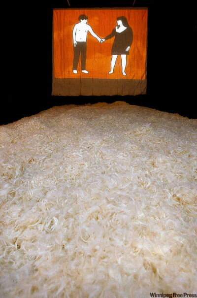 A carpet of feathers leads the way to a screen showing Evan Tapper's ani­mated video.