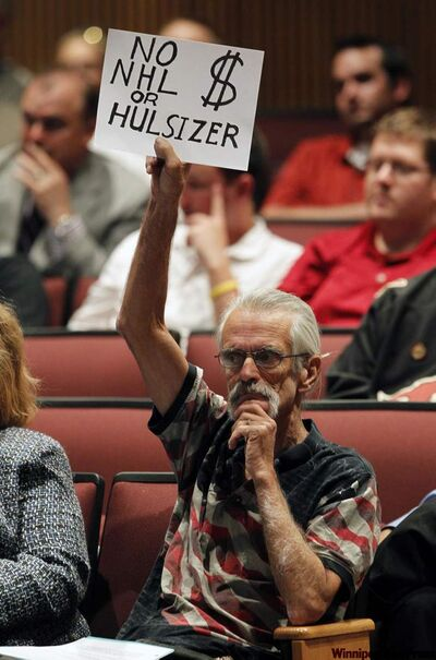 George Sprankle of Glendale shows his displeasure with the Phoenix Coyotes during the Glendale City Council meeting Tuesday evening in Glendale.