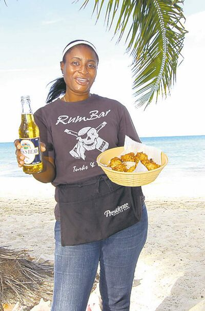Karene Brown serves up the Turk's Head beer cold and the conch fritters hot at Da Conch Shack.