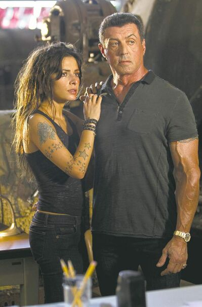Sarah Shahi and Sylvester Stallone in Bullet to the Head.